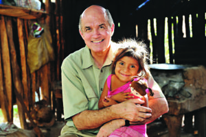 In Santa Rosa, Guatemala, Cross Catholic Outreach CEO Jim Cavnar holds Dulce Maria Martinez, beaming a 100watt smile as she holds the new doll from her Box of Joy. Photo courtesy of Cross Catholic Outreach